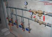Установка поквартирных счетчиков тепла и балансировочной арматуры Herz